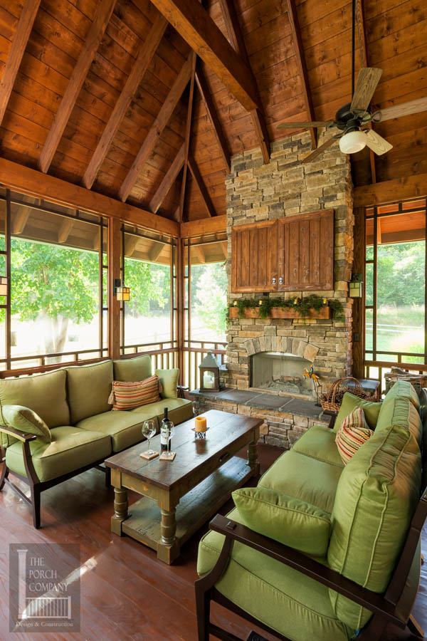 Screened porch beautifully matches home the porch for Screened porch fireplace designs