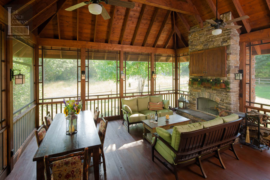 Screened Porch With Seating And Dining Area