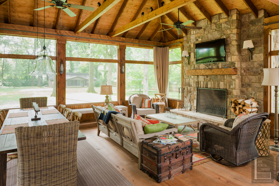 Screened Porch With Exposed Rafter Ceiling And Dining And