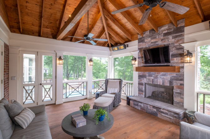 porch-screened-interior-fireplace-mantel-screen-door-southern-cross-railing-cypress-flooring-exposed-ceiling