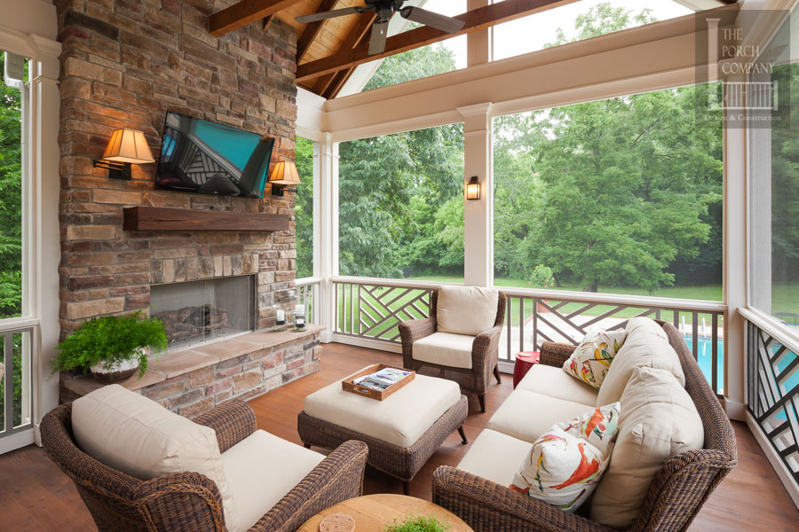 Screened Porch With Chippendale Railings And Fireplace