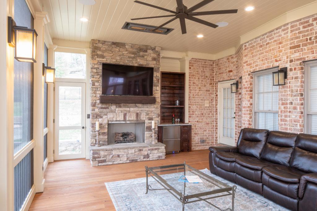 porch-screened-cypress-fireplace-hearth-mantel