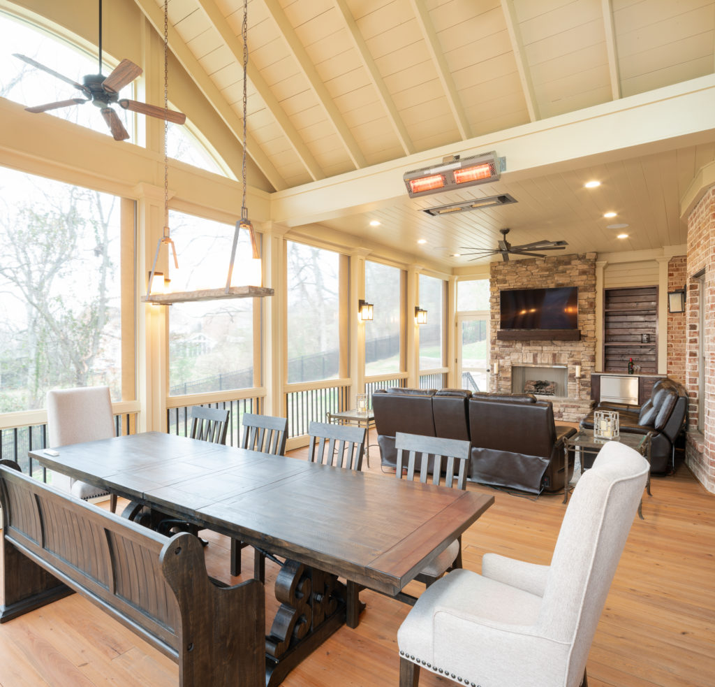 porch-screened-dining-heaters-gable-roof-fireplace-