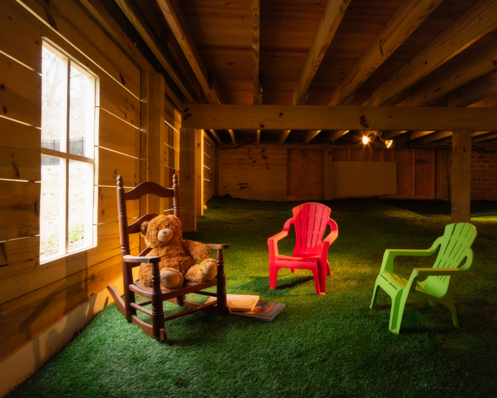 porch-screened-underneath-kids-play-room-storage