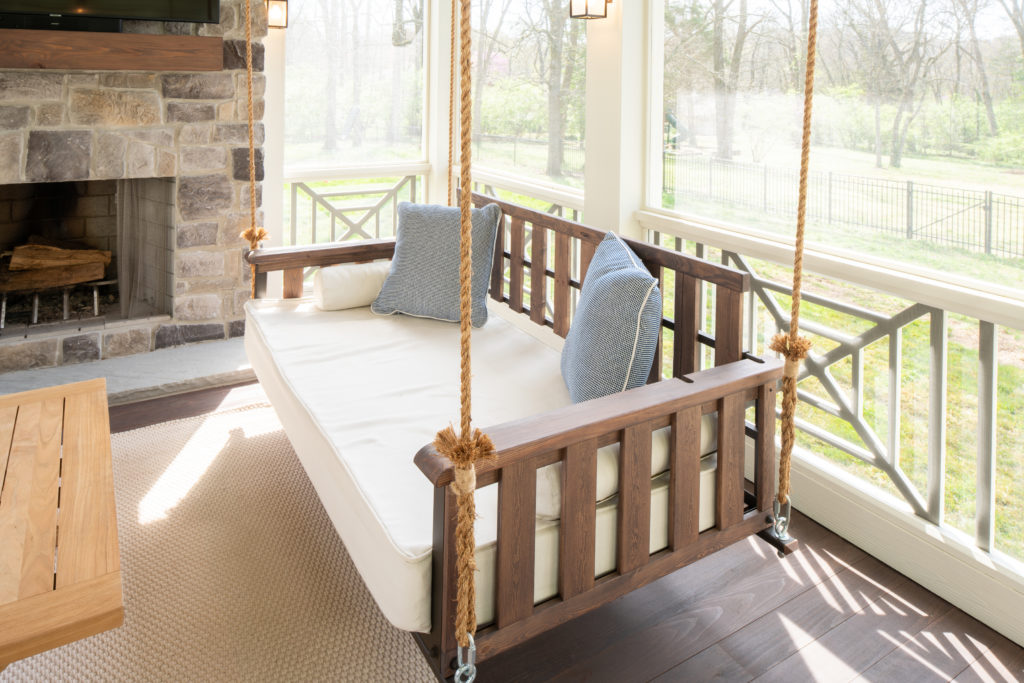 porch-screened-craftsman-bed-swing-brown-fireplace-hearth