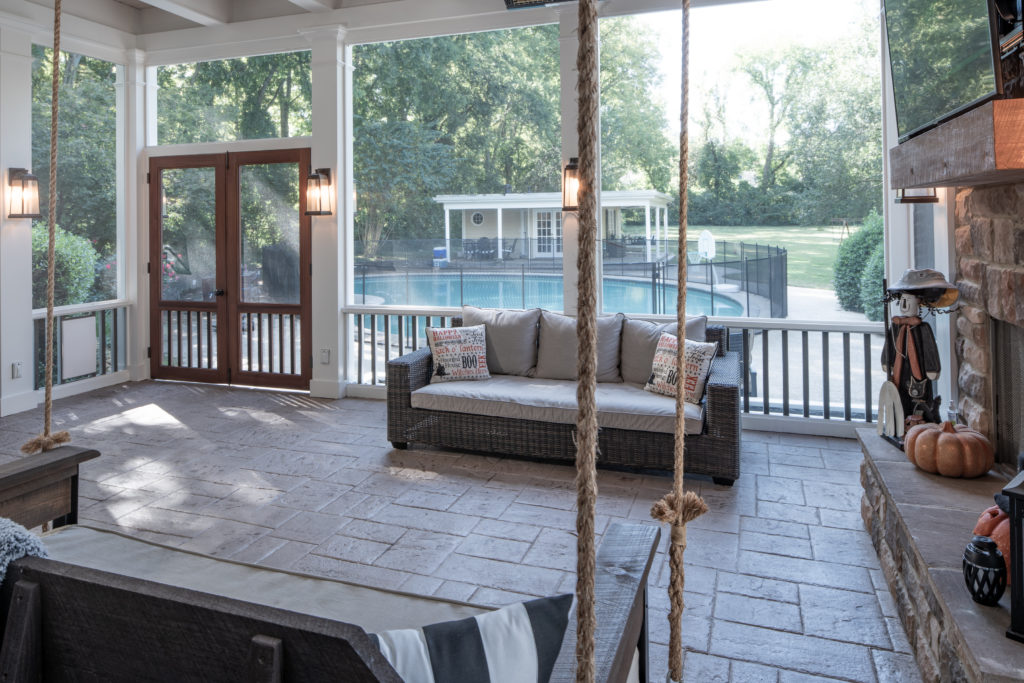 porch-screened-interior-pavers-fireplace-doors-screened-picket-double