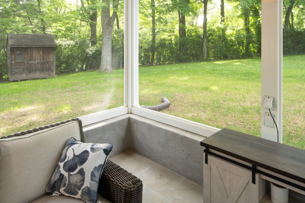 Concrete stem wall and drainage – must-have solutions for this sloping backyard.