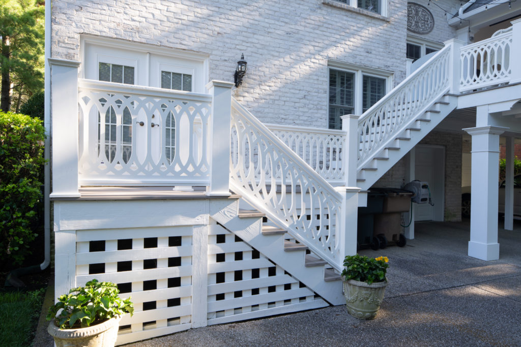 TimberTech AZEK Premier Railing with PorchCo Cathedral Scroll Rail Panel