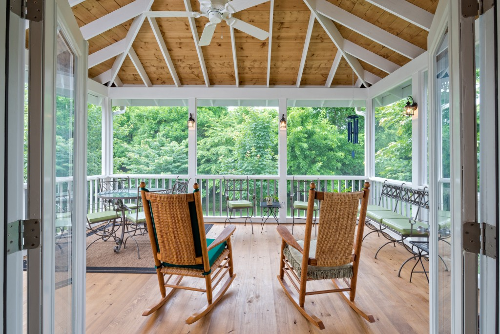 porch-screened-seating-exposed-rafter-ceiling