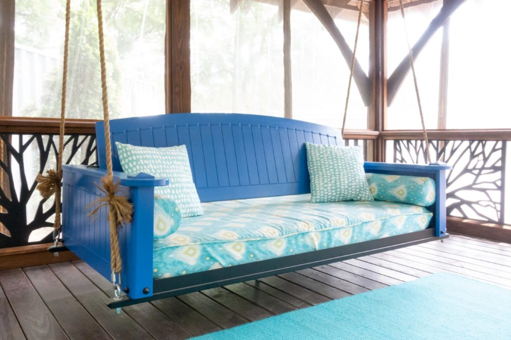 The Retreat Porch swing bed by PorchCo customized in a vibrant color.